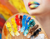 Girl with colored lips with palette Stock Image