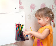 Girl with colored pencils. Little girl with colored pencils Stock Photo