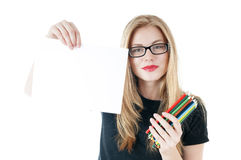 Girl with  colored pencils  and empty white blank  paper. Royalty Free Stock Photography
