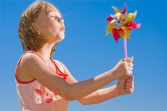 Girl with colored pinwheel Stock Photo