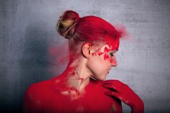 Girl with colored powder Royalty Free Stock Image