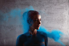 Girl with colored powder Royalty Free Stock Photos