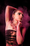 Girl with colored powder Stock Images