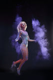 Girl with colored powder Stock Photos