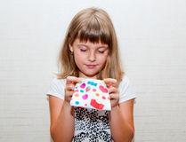Girl with colored purse. Teen girl with colored candy purse searching something Royalty Free Stock Images