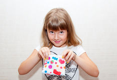 Girl with colored purse Stock Image