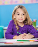 Girl With Colored Sketch Pens And Paper At Desk Royalty Free Stock Photos