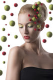 Girl with colored spheres on the face. Portrait of blonde girl with some colored balls on face Royalty Free Stock Photos