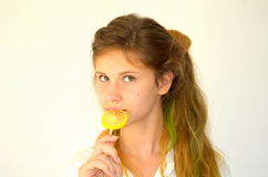 Girl  with colored strands and with a lollipop Stock Photography