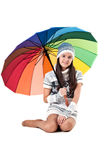 Girl with colored umbrella Stock Images