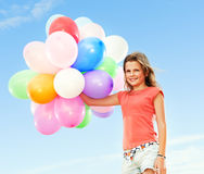 Girl with colorful balloons Stock Photography