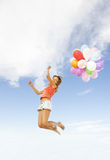 Girl with colorful balloons Royalty Free Stock Photos