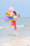 Girl with colorful balloons Royalty Free Stock Photo
