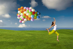 Girl with colorful balloons Royalty Free Stock Image