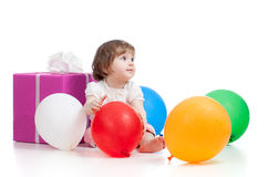 Girl  with colorful balloons and gift. On white background Royalty Free Stock Images