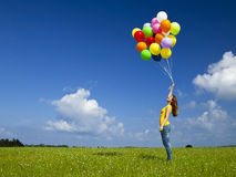 Girl with colorful balloons Stock Images
