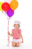 Girl with colorful balloons. Stock Images