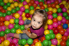 Girl with colorful balls Royalty Free Stock Photo