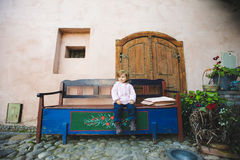 Girl on Colorful Bench Royalty Free Stock Photos