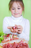 Girl with colorful children's buffet Stock Image