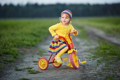 Girl with colorful dress on the bicycle Royalty Free Stock Photos