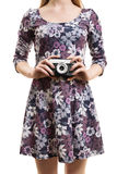 Girl in a colorful dress hodling a vintage camera Stock Photos