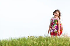 Girl in a colorful dress Stock Images