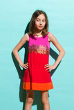 Girl in colorful dress looking away Royalty Free Stock Images
