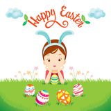 Girl And Colorful Easter Eggs On Lawn. Easter Spring Season Animal Nature Decorating Objects Festive Celebrations Royalty Free Stock Image