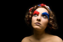Girl with colorful feather Stock Images