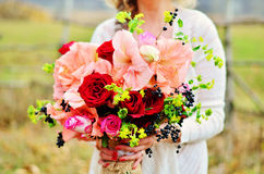 Girl. With colorful flowers bouquet stock image