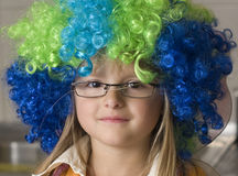 Girl in colorful funny wig Stock Image