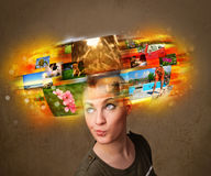 Girl with colorful glowing photo memories concept Royalty Free Stock Image