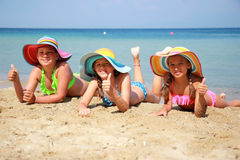 Girl with colorful hat on the beach Royalty Free Stock Image
