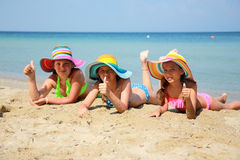 Girl with colorful hat on the beach Royalty Free Stock Photo