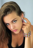 Girl with colorful jewellery Royalty Free Stock Image