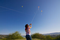 Girl with colorful kites Stock Images