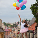 Girl with colorful latex balloons Royalty Free Stock Photography