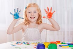 Girl with colorful paints Stock Images