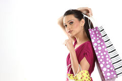 Girl with colorful shopping bags Stock Image