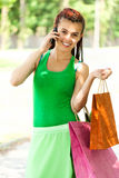 Girl with colorful shopping bags in the park Royalty Free Stock Image