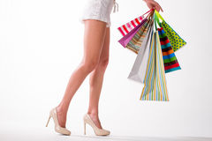 Girl with colorful shopping bags on a white background. Royalty Free Stock Photography