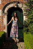 Girl antique wall door, Groot Begijnhof, Leuven, Belgium royalty free stock images