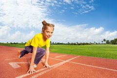 Girl in colorful uniform on start ready to run Royalty Free Stock Images
