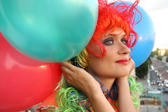 Girl in colorful wig with balloons Royalty Free Stock Photos