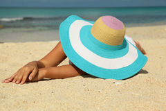 Girl with colorfull hat on the beach Royalty Free Stock Photography
