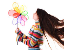 Girl with colorfull windmill Stock Image