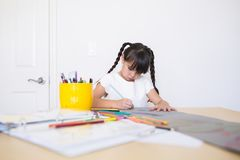 Girl coloring an art work stock images