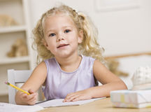 Girl Coloring in Books Stock Image