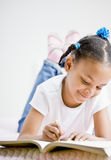 Girl coloring in coloring book. Happy girl coloring in coloring book Royalty Free Stock Photos